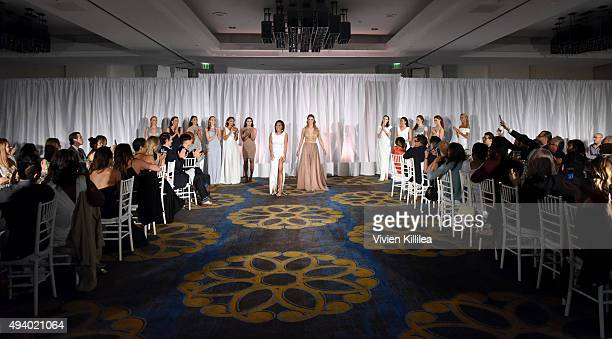 Fashion designer Pia Gladys Perey and model walk the runway at the Pia Gladys Perey Spring/Summer 2016 Fashion Show at Sofitel Hotel on October 23...