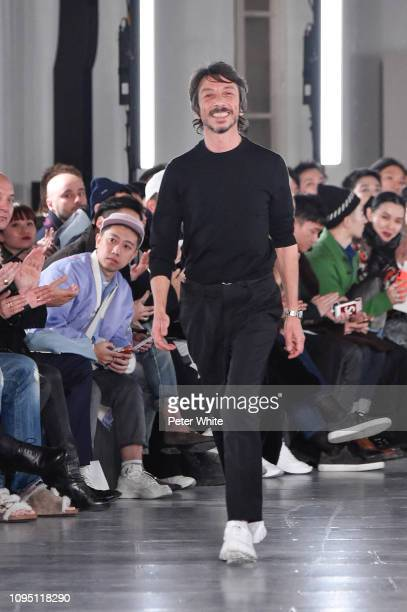 Fashion designer Pierpaolo Piccioli walks the runway during the finale of Valentino Menswear Fall/Winter 20192020 show as part of Paris Fashion Week...