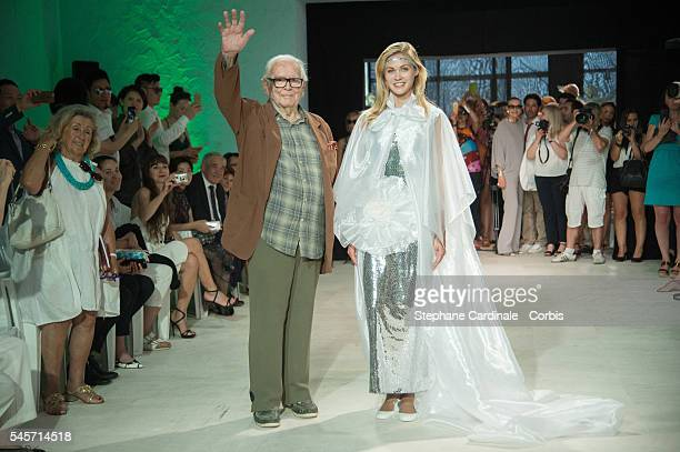 Fashion designer Pierre Cardin and a model walks the runway during the Pierre Cardin 2016 Collection show as part of Paris Fashion Week on July 9...