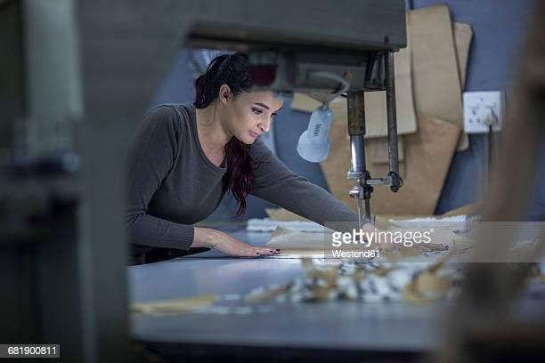 Fashion designer preparing cloth in factory