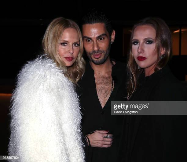 Fashion designer Rachel Zoe makeup artist hairstylist and the Glam App founder CCO Joey Maalouf and socialite Allegra Versace Beck attend the Glam...