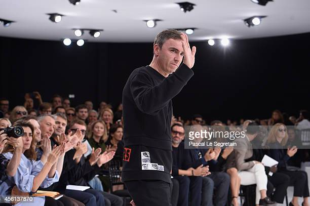 Fashion designer Raf Simons acknowledges the applause of the audience after the Christian Dior show as part of the Paris Fashion Week Womenswear...