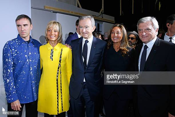 Fashion Designer Raf Simons, Owner of LVMH Luxury Group Bernard Arnault with his wife Helene Arnault and CEO Dior Sidney Toledano and his wife Katia...