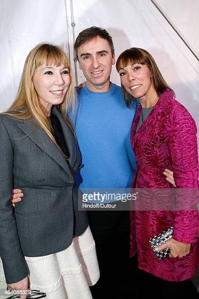 Fashion Designer Raf Simons poses backstage between Victoire de Castellane and Mathilde Favier after the Christian Dior show as part of Paris Fashion...