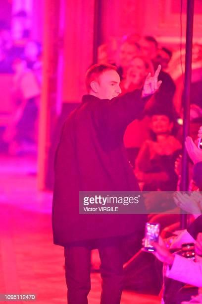 Fashion designer Raf Simons walks the runway during the Raf Simons Menswear Fall Winter 2019/2020 fashion show as part of Paris Fashion Week on...