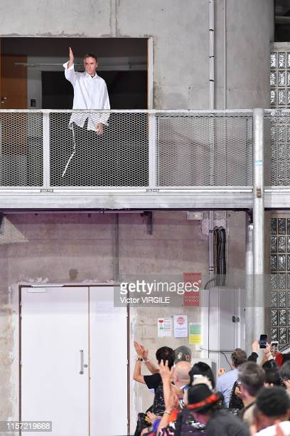 Fashion designer Raf Simons walks the runway during the Raf Simons Menswear Spring Summer 2020 show as part of Paris Fashion Week on June 19, 2019 in...