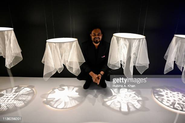 Fashion designer Rahul Mishra poses with his work at the third edition of Chivas 18 Alchemy 2019 on March 16 2019 in New Delhi India