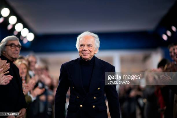 US fashion designer Ralph Lauren greets attendees after presenting his creations during the New York Fashion Week on February 12 in New York / AFP...