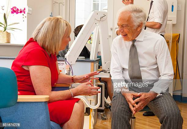 Fashion designer Ralph Lauren meets breast cancer patient Kathryn England as he and Prince William Duke of Cambridge visit the Royal Marsden NHS...
