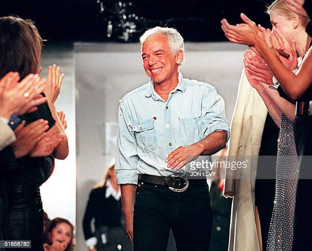 Fashion designer Ralph Lauren receives applause from models and guests after the showing of his Fall 1997 Collection 09 April in New York. Over 50...