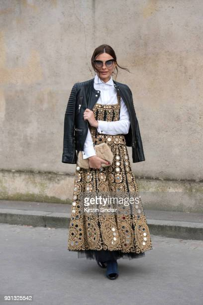 Fashion designer Ramona Filip wears a Ramona Filip dress Sandro jacket Miu miu sunglasses Gucci bag day 2 of Paris Womens Fashion Week Spring/Summer...