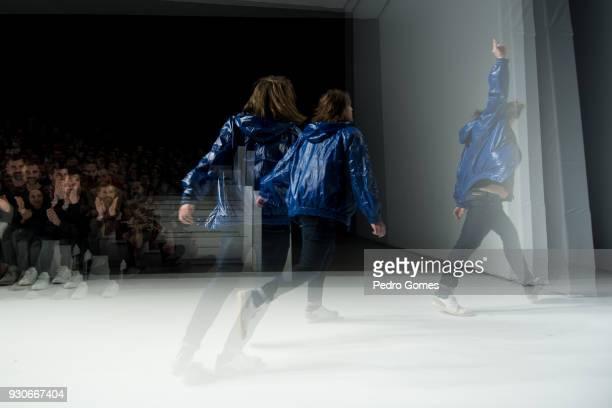 Fashion designer Ricardo Andrez runs on the runway at the end of his show during Lisboa Fashion Week 'ModaLisboa' 2018 on March 11 2018 in Lisbon...