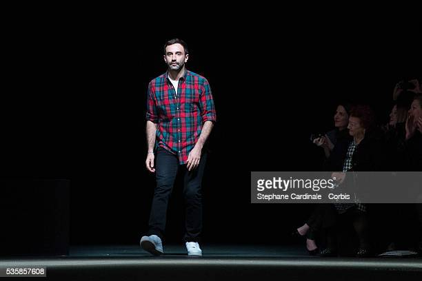 Fashion designer Riccardo Tisci acknowledges applause following the Givenchy Fall/Winter 2013/14 Ready-to-Wear show as part of Paris Fashion Week, in...