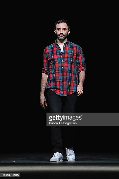 Fashion designer Riccardo Tisci acknowledges applause foolowing the Givenchy Fall/Winter 2013 Ready-to-Wear show as part of Paris Fashion Week on...