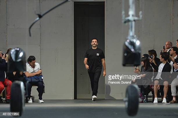 Fashion designer Riccardo Tisci acknowledges the applause of the audience after the Givenchy show as part of the Paris Fashion Week Menswear...