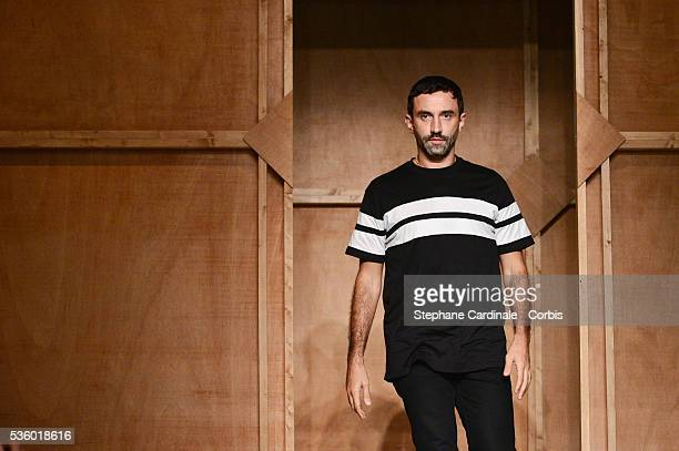 Fashion designer Riccardo Tisci acknowledges the applause of the audience after the Givenchy show as part of the Paris Fashion Week Womenswear...