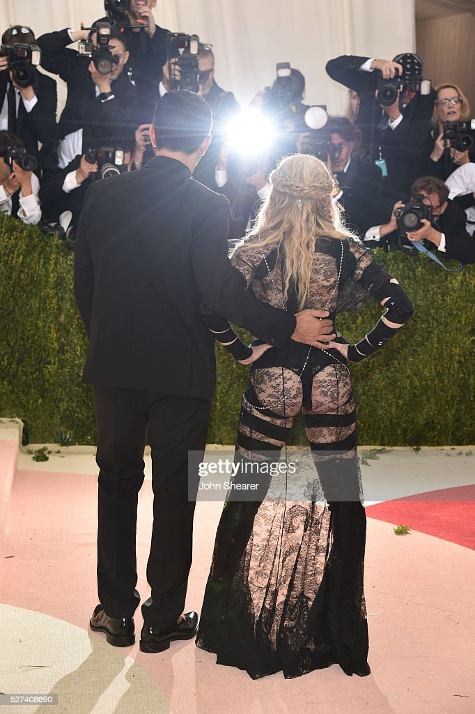 Fashion designer Riccardo Tisci (L) and Madonna attend the 'Manus x Machina: Fashion In An Age Of Technology' Costume Institute Gala at Metropolitan Museum of Art on May 2, 2016 in New York City.