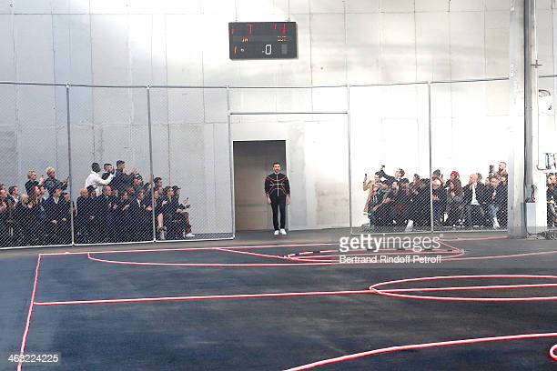 Fashion Designer Riccardo Tisci hi the public at the end of the Givenchy Menswear Fall/Winter 20142015 Show as part of Paris Fashion Week Held at...