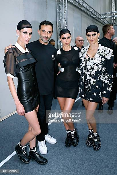 Fashion designer Riccardo Tisci poses backstage with model Adriana Lima and others models after the Givenchy show as part of the Paris Fashion Week...