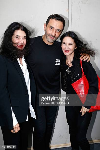 Fashion designer Riccardo Tisci poses backstage with Pianists Marielle and her sister Katia Labeque after the Givenchy show as part of the Paris...