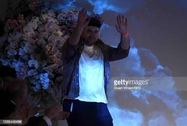 Fashion designer Richard Quinn walks the runway at the finale of his show during London Fashion Week September 2018 on September 18 2018 in London...