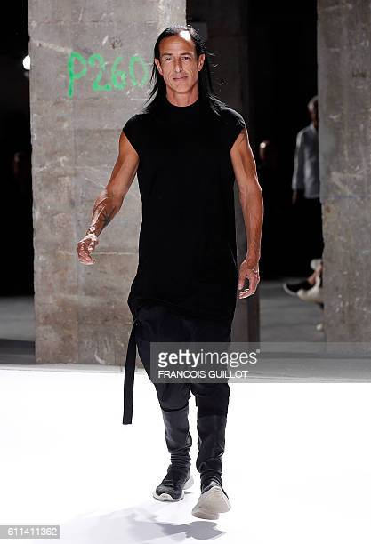 US fashion designer Rick Owens acknowledges the audience at the end of the 2017 Spring/Summer readytowear collection fashion show on September 29...