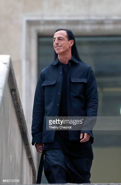 US fashion designer Rick Owens acknowledges the audience at the end of the Rick Owens show as part of the Paris Fashion Week Womenswear Spring/Summer...
