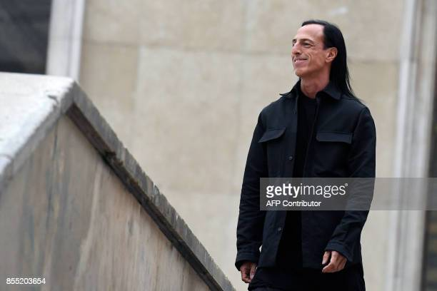 US fashion designer Rick Owens acknowledges the public at the end of his women's 2018 Spring/Summer readytowear collection fashion show in Paris on...
