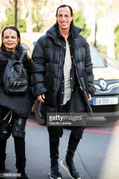 Fashion designer Rick Owens wearing a long black jacket black shirt black pants and black sneakers is seen in the streets of Paris before the Issey...