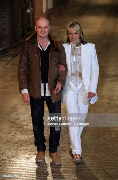 Fashion designer Robert CaryWilliams with actress Anita Pallenberg receiving applause from the audience after his Autumn/Winter 2000 collection on...