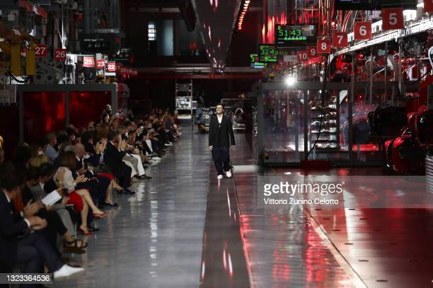 Fashion designer Rocco Iannone walks the runway at the end of fashion debut of the first co-ed Ferrari collection at Ferrari Factory on June 13, 2021...