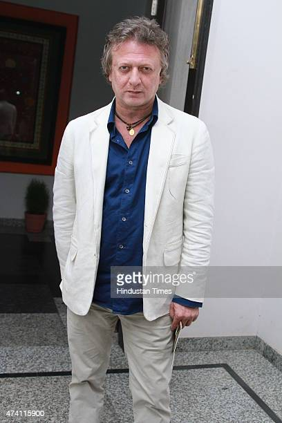 Fashion designer Rohit Bal poses after the meeting with Minister Of State For Textiles Santosh Gangwar on May 18 2015 in New Delhi India