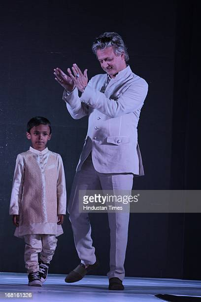 Fashion designer Rohit Bal with a kid at the Annual Charity event Fashion For A Cause organized by NGO Lakshyam to help unprivileged children at...