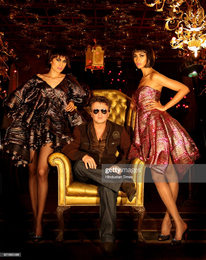 Fashion designer Rohit Bal with models during his preview for Wills Fashion Week, in New Delhi.