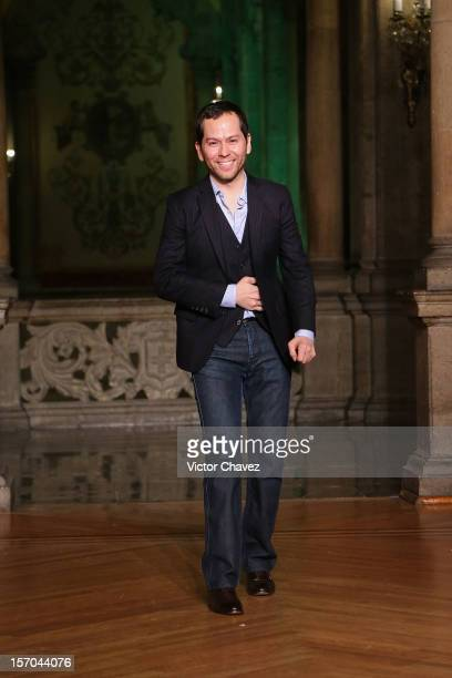 Fashion designer Rolando Santana walks the runway during the Rolando Santana Spring/Summer 2013 fashion show at Casino Español on November 27 2012 in...