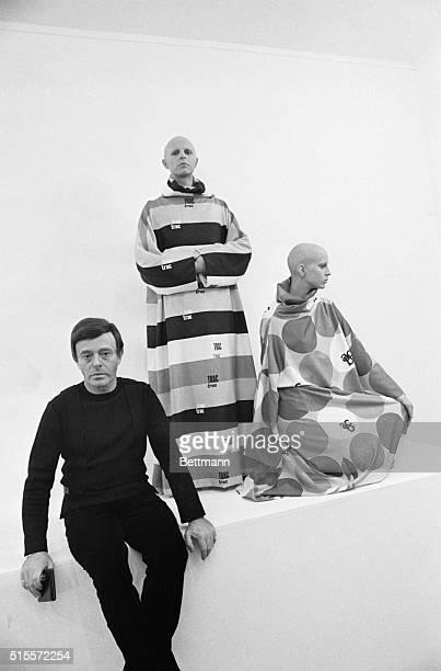 Fashion designer Rudi Gernreich with two models dressed in his futuristic unisex designs