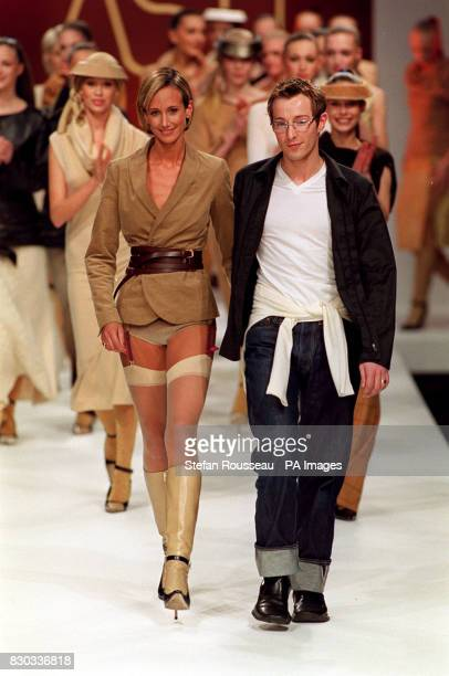 Fashion designer Scott Henshall joins his models on the catwalk after his Autumn/Winter 2000 collection during London Fashion Week