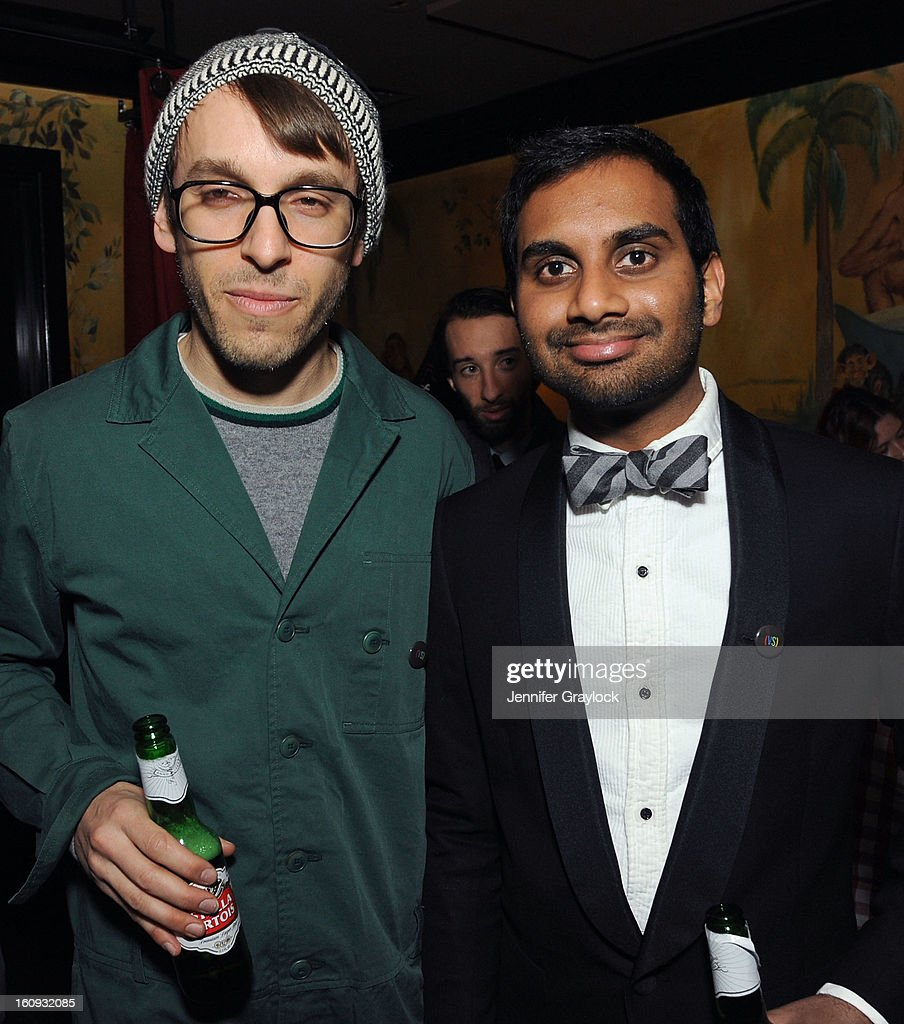 Fashion designer Scott Sternberg and Aziz Ansari attend the Band Of Outsiders Fashion Week Mens Collection After Party held at the Monkey Bar on February 7, 2013 in New York City.