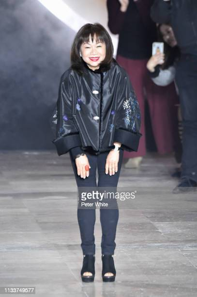 Fashion designer Shiatzy Chen acknowledges the audience at the end of the Shiatzy Chen show as part of the Paris Fashion Week Womenswear Fall/Winter...