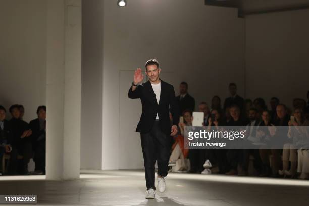 Fashion designer Simon Holloway acknowledges the applause of the audience at the Agnona show at Milan Fashion Week Autumn/Winter 2019/20 on February...