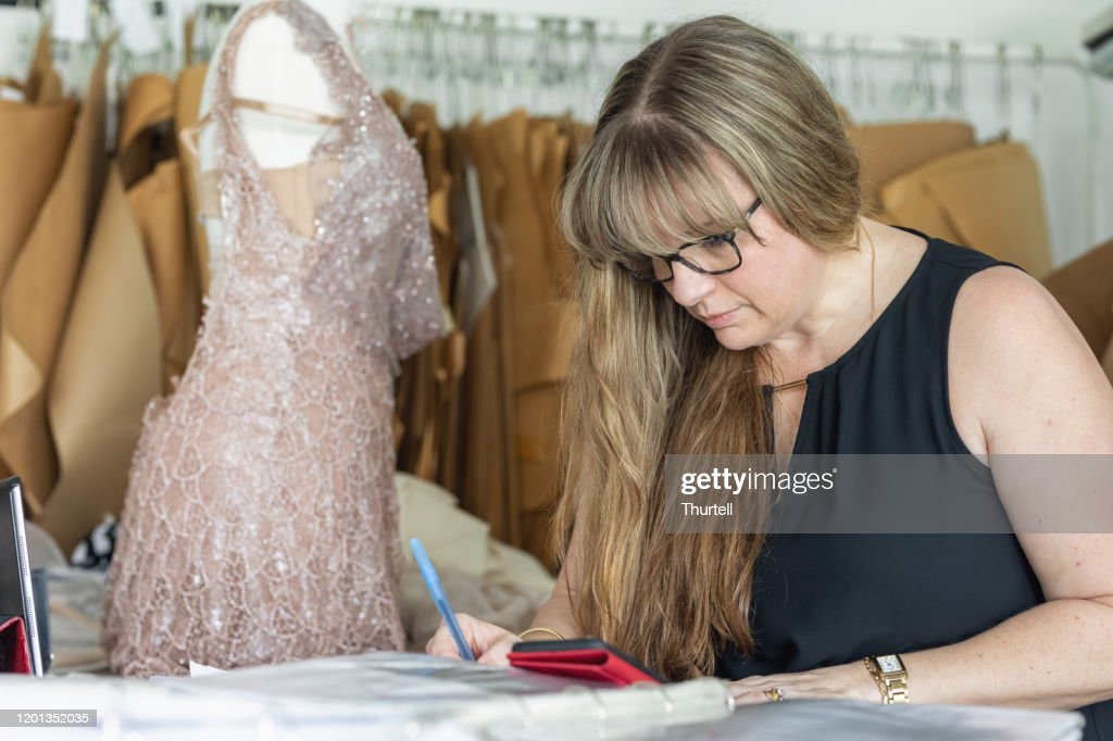 Fashion Designer Sketching Dress Ideas In Home Studio High Res Stock Photo Getty Images