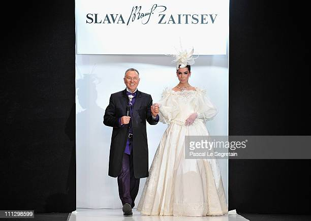 Fashion designer Slava Zaitsev with a model on the catwalk after his show on Day 1 of the MercedesBenz Fashion Week Russia Fall/Winter 2011/2012 at...