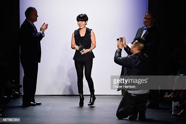 Fashion Designer Son Jung Wan walks the runway holding her Silver Needle Award Son Jung Wan Spring 2016 during New York Fashion Week The Shows at The...