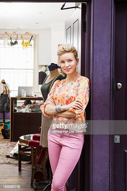 fashion designer standing in door of fashion shop. - design professional stock pictures, royalty-free photos & images