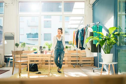 Fashion designer standing in her studio - gettyimageskorea