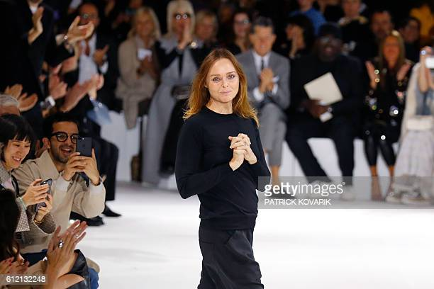 TOPSHOT Fashion designer Stella McCartney acknowledges the audience at the end of her 2017 Spring/Summer readytowear collection fashion show on...