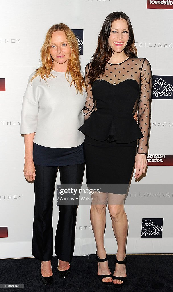 Fashion designer Stella McCartney and actress Liv Tyler attend a cocktail reception celebrating the launch of the new Stella McCartney boutique at Saks Fifth Avenue on May 4, 2011 in New York City.
