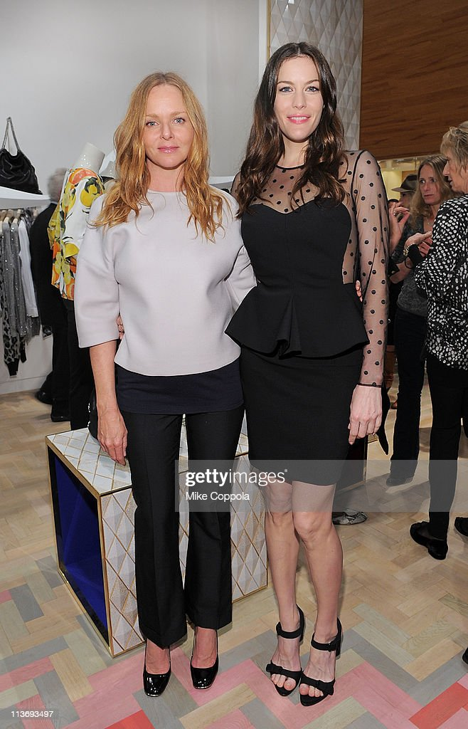 Fashion designer Stella McCartney (L) and actress Liv Tyler attend the launch of the new Stella McCartney boutique at Saks Fifth Avenue on May 4, 2011 in New York City.