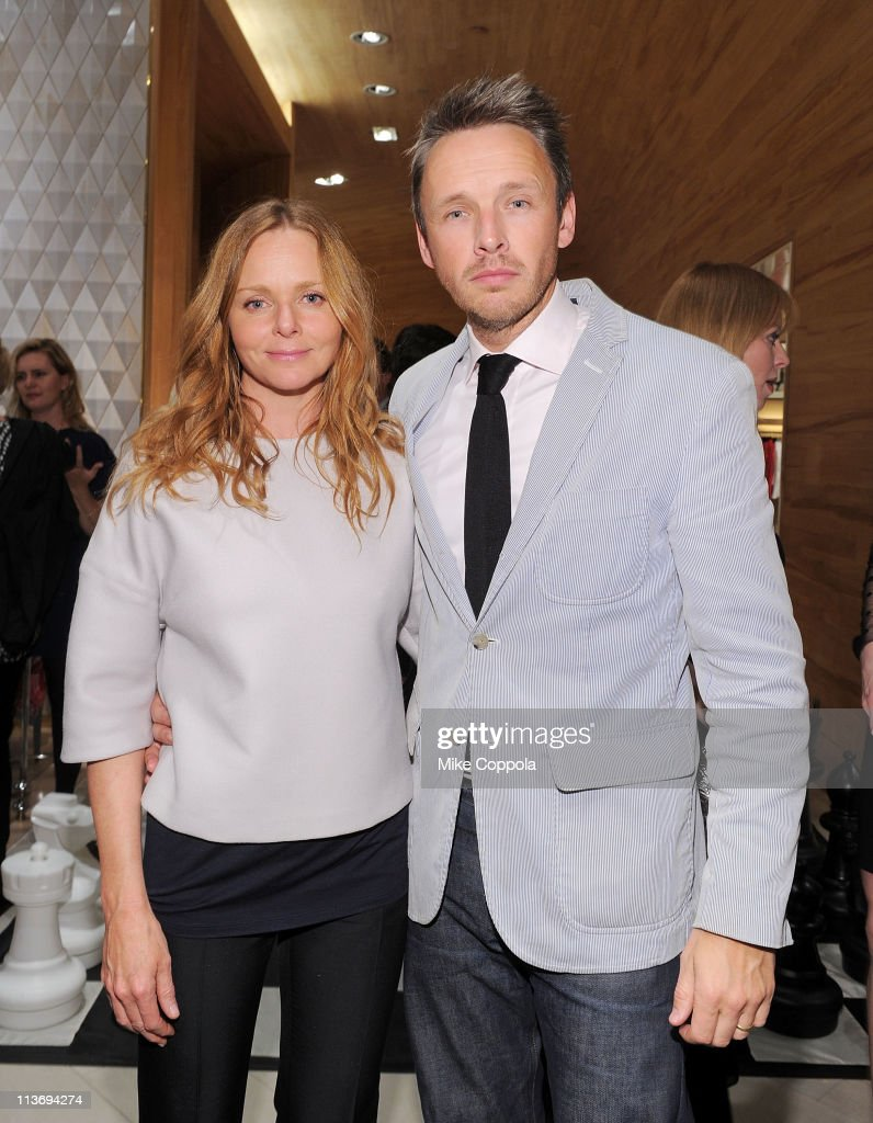 Fashion designer Stella McCartney (L) and husband Alasdhair Willis attend the launch of the new Stella McCartney boutique at Saks Fifth Avenue on May 4, 2011 in New York City.