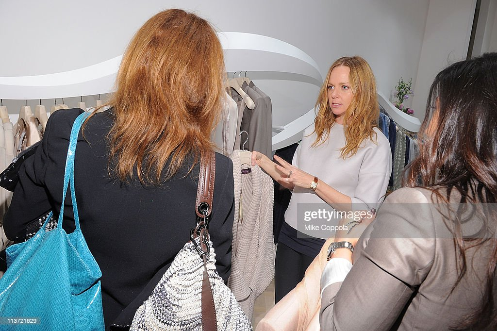 Fashion designer Stella McCartney helps customers at the launch of the new Stella McCartney boutique at Saks Fifth Avenue on May 4, 2011 in New York City.